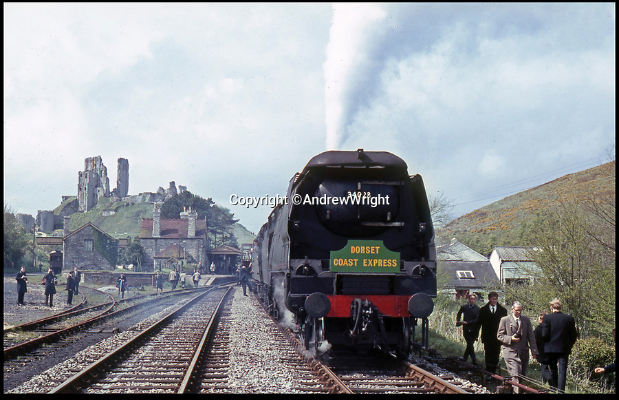 BNPS.co.uk (01202 558833)<br /> Pic: AndrewWright/BNPS<br /> <br /> The Dorset Express pauses at Corfe Castle, May 1967.<br /> <br /> A public train service is to run on a railway line ripped up in the 'Beeching Axe' thanks to an army of volunteers who have spent 45 years painstakingly rebuilding it. From next month timetabled passenger trains will operate on a daily basis from the mainline down to Swanage in Dorset.The Victorian town was effectively cut off from the rail network in 1972 after Dr Richard Beeching, a government railway advisor, recommended it be one of hundreds of loss-making rural lines axed.Since then hundreds of people have restored the track which has been upgraded to meet today's safety standards.