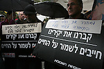 Members of a group that supports family members of terror victims, holds signs supporting the trade of terrorists for captive soldier Gilad Schalit outside the Israeli Prime Ministers house on March 15, 2009. Prime Minister Olmert said they will decide on a deal to free schalit by Monday. .Photo: Maya Levin/ Jini