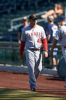 Scottsdale Scorpions pitching coach Michael Wuertz (48), of the Los Angeles Angels of Anaheim organization walks to the dugout before a game against the Mesa Solar Sox on October 21, 2016 at Sloan Park in Mesa, Arizona.  Mesa defeated Scottsdale 4-3.  (Mike Janes/Four Seam Images)