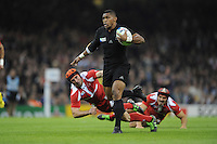 Waisake Naholo of New Zealand hands off Beka Tsiklauri of Georgia on his way to scoring a try during Match 23 of the Rugby World Cup 2015 between New Zealand and Georgia - 02/10/2015 - Millennium Stadium, Cardiff<br /> Mandatory Credit: Rob Munro/Stewart Communications