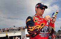 Jul. 4, 2008; Daytona Beach, FL, USA; NASCAR Sprint Cup Series driver Jeff Gordon signs autographs during qualifying for the Coke Zero 400 at Daytona International Speedway. Mandatory Credit: Mark J. Rebilas-