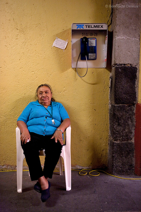 Conchita, a resident of Casa Xochiquetzal, is seating on a plastic chair at the shelter in Mexico City, Mexico on April 16, 2009. Casa Xochiquetzal is a shelter for elderly sex workers in Mexico City. It gives the women refuge, food, health services, a space to learn about their human rights and courses to help them rediscover their self-confidence and deal with traumatic aspects of their lives. Casa Xochiquetzal provides a space to age with dignity for a group of vulnerable women who are often invisible to society at large. It is the only such shelter existing in Latin America. Photo by Bénédicte Desrus