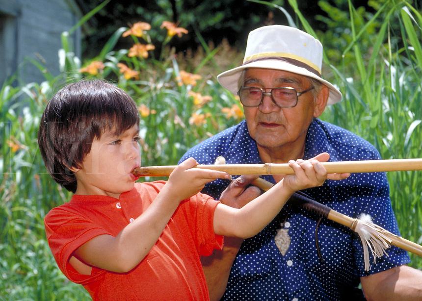 5 year-old Cherokee  boy shoots dart through a blowgun his grandfather has made, Yahlequah, OK