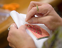 NWA Democrat-Gazette/BEN GOFF &bull; @NWABENGOFF<br /> Lois Allen of Bella Vista works on a cross stitch design on Monday Aug. 3, 2015 during the weekly meeting of the B&rsquo;Creative Stitchers at the Bella Vista Public Library.