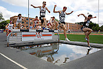 28 MAY 2016: Competitors clear the water feature of the men's 3000 Meter Steeplechase enters its second lap during the Division III Men's and Women's Outdoor Track & Field Championship held at Walston Hoover Stadium on the Wartburg College campus in Waverly, IA. Ryan Bugler               of St. John's (Minn.) won the event with a time of 9:11.98. Conrad Schmidt/NCAA Photos