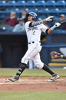 Asheville Tourists right fielder Jonathan Daza (2) swings at a pitch during a game against the Hickory Crawdads on April 22, 2015 in Asheville, North Carolina. The Crawdads defeated the Tourists 6-1. (Tony Farlow/Four Seam Images)