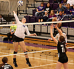 SIOUX FALLS, SD - SEPTEMBER 23: Michelle Ritland #12 from University of Sioux Falls winds up for a kill past Alyssa Frauendorfer #10 from Wayne State Tuesday night at the Stewart Center.  (Photo by Dave Eggen/Inertia)