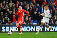 Gareth Bale of Wales vies for possession with Martin Braithwaite of Denmark during the UFEA Nations League B match between Wales and Denmark at The Cardiff City Stadium in Cardiff, Wales, UK. Friday 16 November 2018