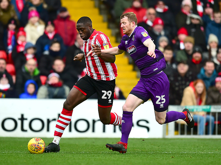 Lincoln City's John Akinde vies for possession with Grimsby Town's Alex Whitmore<br /> <br /> Photographer Andrew Vaughan/CameraSport<br /> <br /> The EFL Sky Bet League Two - Lincoln City v Grimsby Town - Saturday 19 January 2019 - Sincil Bank - Lincoln<br /> <br /> World Copyright &copy; 2019 CameraSport. All rights reserved. 43 Linden Ave. Countesthorpe. Leicester. England. LE8 5PG - Tel: +44 (0) 116 277 4147 - admin@camerasport.com - www.camerasport.com