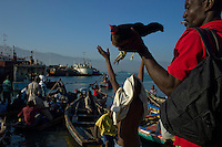 Port Au Prince, Haiti, Jan 24 2010.Port Jeremie is where the ferries to the south-west are docking in Port au Prince; everytime a ferry make shore, hundreds of people gather to try and find a passage, as the west was relatively spared by the earthquake. A passage to the town of Jeremie cost the equivalent of U$30, a large sum by Haitian standards..
