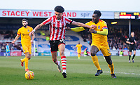 Lincoln City's Lee Angol shields the ball from Northampton Town's Aaron Pierre<br /> <br /> Photographer Chris Vaughan/CameraSport<br /> <br /> The EFL Sky Bet League Two - Lincoln City v Northampton Town - Saturday 9th February 2019 - Sincil Bank - Lincoln<br /> <br /> World Copyright &copy; 2019 CameraSport. All rights reserved. 43 Linden Ave. Countesthorpe. Leicester. England. LE8 5PG - Tel: +44 (0) 116 277 4147 - admin@camerasport.com - www.camerasport.com