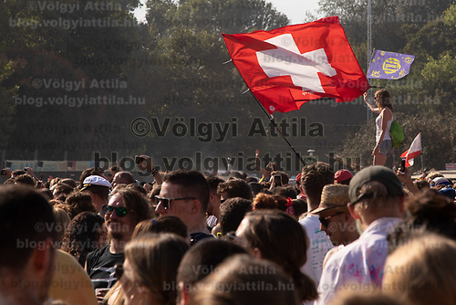 Revellers wave flags in front of the Main Stage at Sziget Festival held in Budapest, Hungary on Aug. 13, 2018. ATTILA VOLGYI