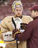 Michael Shibrowski (MN - 1), Justin Johnson (MN - Volunteer Assistant Coach) - The University of Minnesota Golden Gophers took part in a press conference and practice on Friday, April 11, 2014, during the 2014 Frozen Four at the Wells Fargo Center in Philadelphia, Pennsylvania.