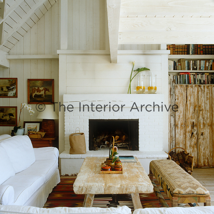 Driftwood, brick and rough-hewn pine create a pleasing contrast of texture in a contemporary yet rustic living room