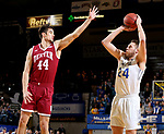 BROOKINGS, SD - JANUARY 13: Mike Daum #24 from South Dakota State University shoots over Daniel Amigo #44 from Denver during their game Saturday afternoon at Frost Arena in Brookings, SD.  (Photo by Dave Eggen/Inertia)