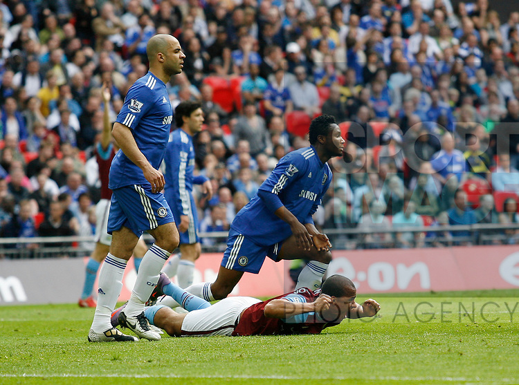 Aston Villa's Gabriel Agbonlahor gets brought down by Chelsea's John Mikel Obi but no penalty is given