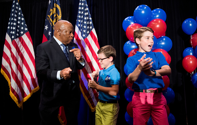 UNITED STATES - JUNE 20: Rep. John Lewis, D-Ga., dances on stage with two boys before speaking at Jon Ossoff's election night watch party in Atlanta on June 20, 2017. Democrat Ossoff faced off against Republican Karen Handel in the special election to fill the seat vacated by current HHS Secretary Tom Price. (Photo By Bill Clark/CQ Roll Call)