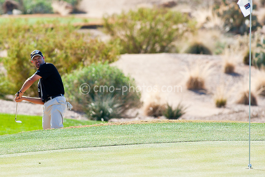 Feb 1, 2009; Scottsdale, AZ, USA; Cliff Kresge (USA) makes a face while his ball travels into the hole during a chip-in birdie on the 4th hole during the final round of the FBR Open at the TPC Scottsdale.  Mandatory Credit: Chris Morrison-US PRESSWIRE