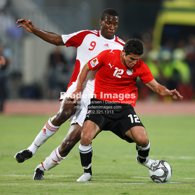 ALEXANDRIA, EGYPT - SEPTEMBER 24:  Jamaal Gay of Trinidad and Tobago (9) pressures Islam Ramadan of Egypt (12) during a FIFA U-20 World Cup soccer match September 24, 2009 in Alexandria, Egypt.  (Photograph by Jonathan P. Larsen)
