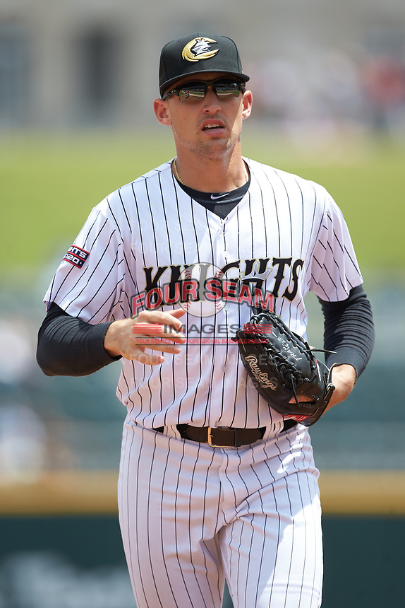 Charlotte Knights center fielder Trayce Thompson (4) jogs off the field between innings of the game against the Indianapolis Indians at BB&T BallPark on August 22, 2018 in Charlotte, North Carolina.  The Indians defeated the Knights 6-4 in 11 innings.  (Brian Westerholt/Four Seam Images)