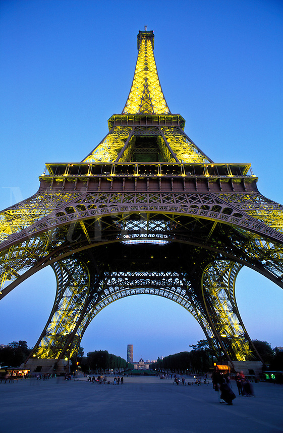 France, Paris,The Eiffel Tower illuminated at night  as viewed from below the tower