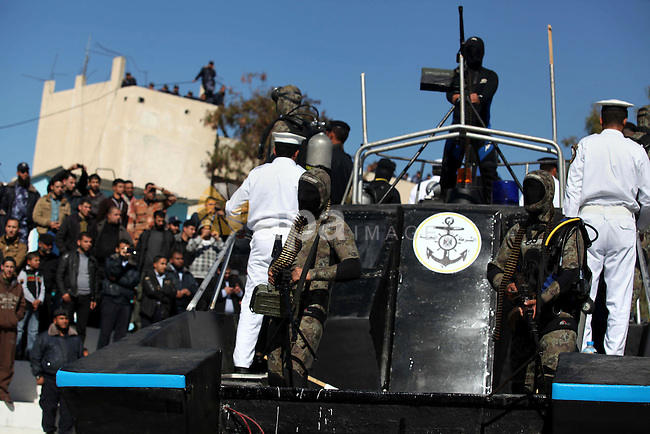 Palestinian policemen loyal to Hamas march during a graduation ceremony in Gaza City January 29, 2014. Photo by Ashraf Amra