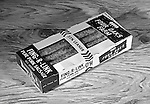 Pittsburgh PA:  Studio photography of a Four Oaks Farm box of Fing-R-Link pure pork sausage.  Assignment was for A.W. Ripple Printing company - 1954.  Four Oaks Farm is a fourth generation company located in Lexington South Carolina.
