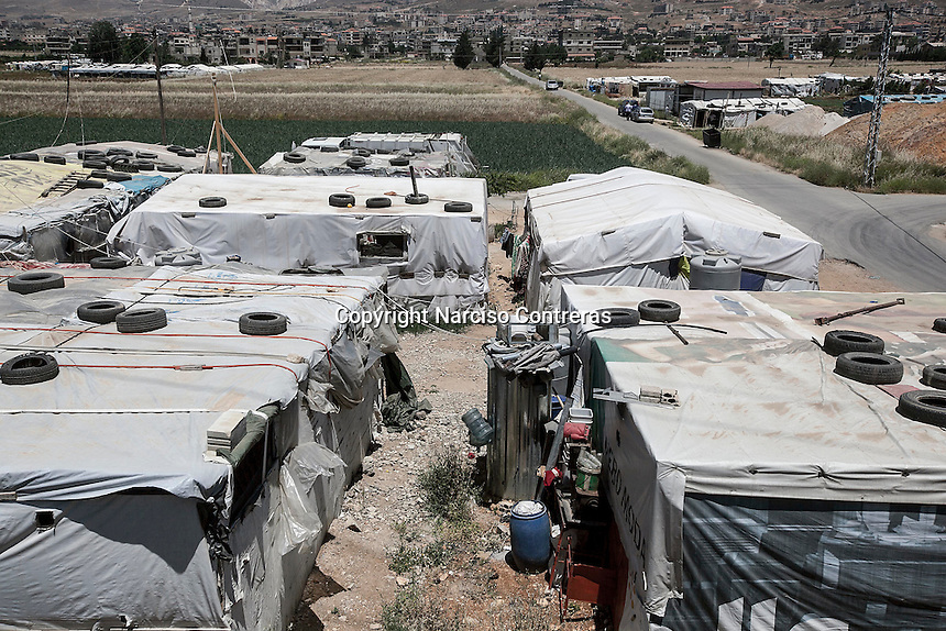 June 11, 2015 - Bekaa Valley, Lebanon: An upper view of one temporary settlement for Syrian refugees in Saadnayel city in east of Lebanon. (Photo/Narciso Contreras)