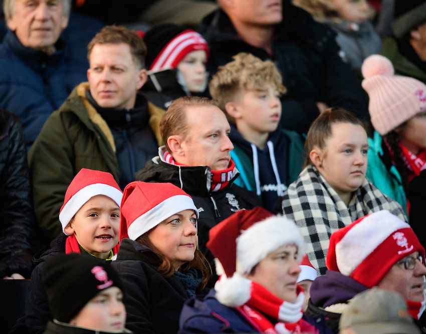 Lincoln City fans watch their team in action<br /> <br /> Photographer Chris Vaughan/CameraSport<br /> <br /> The EFL Sky Bet League Two - Lincoln City v Newport County - Saturday 22nd December 201 - Sincil Bank - Lincoln<br /> <br /> World Copyright © 2018 CameraSport. All rights reserved. 43 Linden Ave. Countesthorpe. Leicester. England. LE8 5PG - Tel: +44 (0) 116 277 4147 - admin@camerasport.com - www.camerasport.com