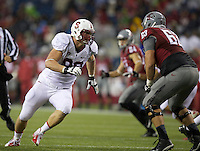 SEATTLE, WA - September 28, 2013: Stanford defensive end Josh Mauro rushes the quarterback as Washington State offensive linesman Gunnar Eklund blocks during at CenturyLink Field. Stanford won 55-17