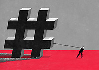 Businessman dragging large hashtag symbol on chain ExclusiveImage