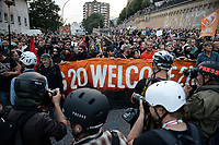 "GERMANY, Hamburg, protest rally ""G-20 WELCOME TO HELL"" against G-20 summit in july 2017, black block with mummed people /DEUTSCHLAND, Hamburg, Landungsbruecken, Protest Demo WELCOME TO HELL gegen G20 Gipfel , vermummte Demonstranten des schwarzen Block,  links mit Ledermuetze Andreas Beuth, Anwalt des linksalternativen Zentrums ""Rote Flora"""