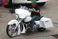May 6, 2017; Commerce, GA, USA; NHRA pro stock driver Bo Butner rides a Harley Davidson motorcycle in the pits during qualifying for the Southern Nationals at Atlanta Dragway. Mandatory Credit: Mark J. Rebilas-USA TODAY Sports