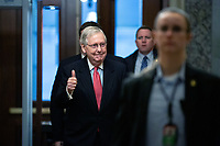 United States Senate Majority Leader Mitch McConnell (Republican of Kentucky) gives a thumbs up as he arrives to the United States Capitol in Washington D.C., U.S. on Wednesday, March 25, 2020.  The Senate is set to vote on a Coronavirus Stimulus Package after working late into the night on Tuesday to finalize a two trillion dollar deal.  Credit: Stefani Reynolds / CNP/AdMedia