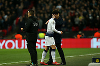 Son Heung-Min of Tottenham Hotspur gets a hug from Tottenham Hotspur manager Mauricio Pochettino after being substituted during Tottenham Hotspur vs Borussia Dortmund, UEFA Champions League Football at Wembley Stadium on 13th February 2019