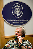 Crawford, TX - August 12, 2006 -- United States President George W. Bush speaks with the Prime Minister Fuad Siniora of Lebanon during a phone call at the Bush Ranch in Crawford, Texas, Saturday, August 12, 2006. .Credit : Eric Draper-White House via CNP