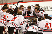 The Huskies gather around their net prior to the game. - The visiting Bentley University Falcons defeated the Northeastern University Huskies 3-2 on Friday, October 16, 2015, at Matthews Arena in Boston, Massachusetts.