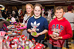 Christmas Craft Fair in aid of Oncology Unit UHK and Glebe Lodge at the River Island Hotel, Castleisland on Saturday were Rachel O'Sullivan, Anna Lynch and Jack O'Sullivan with their Xmas Homemade Baking