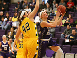 SIOUX FALLS, SD - DECEMBER 31: Jacey Huinker #23 from the University of Sioux Falls drives to the basket against Naomi Rust #42 from Augustana University during their game Sunday afternoon December 31, 2017 at the Stewart Center in Sioux Falls. (Photo by Dave Eggen/Inertia)