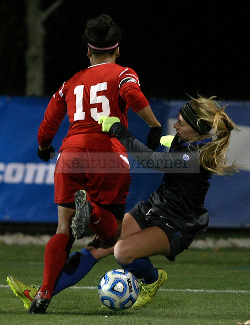 SIUE senior defender Samantha Jones (15) battles UK freshman forward Kelly Novak (12) for the ball during the University of Kentucky vs. Southern Illinois University Edwardsville women's soccer game at the Soccer Complex in Lexington, Ky., on Saturday, November 15, 2014. The game was the first round of the 2014 NCAA tournament and UK won 4-2 in overtime penalty kicks. Photo by Tessa Lighty | Staff