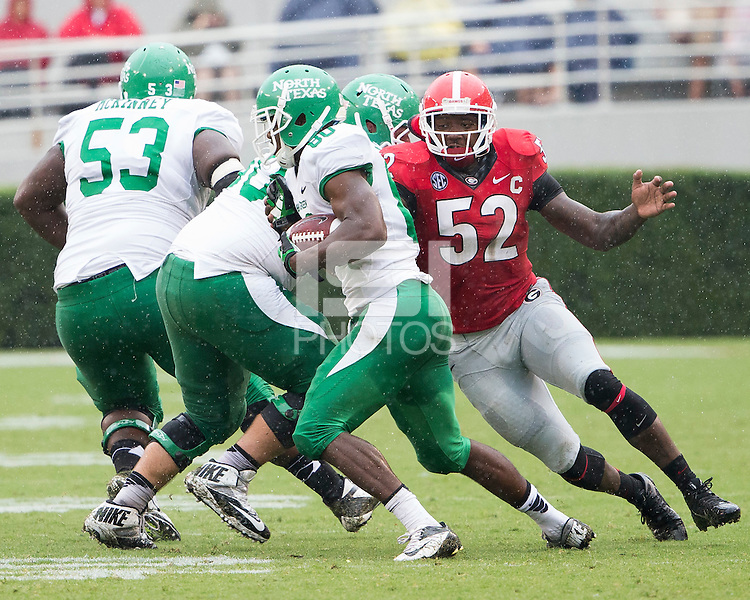 The Georgia Bulldogs played North Texas Mean Green at Sanford Stadium.  After North Texas tied the game at 21 early in the second half, the Georgia Bulldogs went on to score 24 unanswered points to win 45-21.  North Texas Mean Green wide receiver Darnell Smith (80), Georgia Bulldogs linebacker Amarlo Herrera (52)