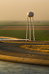 California Aqueduct and water storage tower at sunset in the Central Valley, near Los Banos, Merced County,California