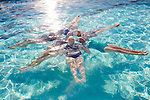 The Aqua Suns are a group of synchronized swimmers in Sun City, Arizona, an age-restricted city of retirees. They pose for a photo at the Lakeview Recreation Center Pool December 2, 2013.