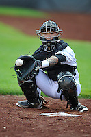 Christian Carmichael #33 of the Clinton LumberKings warms up the pitcher in the bullpen prior to the game against the Kane County Cougars at Ashford University Field on July 5, 2014 in Clinton, Iowa. The Cougars won 4-0.   (Dennis Hubbard/Four Seam Images)