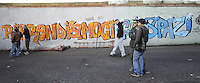 Roma, 27 Marzo 2009.Via Prenestina. Metropoliz. casa occupano i capannoni abbandonati della ex fabbrica di salumi Fiorucci..Nel murales:riprendiamoci gli spazi.Rome, 27 March 2009.Via Prenestina. Homeless occupy the abandoned warehouses of the former sausage factory Fiorucci..the murals: Reclaim spaces