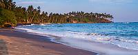 Panoramic photo of Mirissa Beach, South Coast of Sri Lanka, Asia. This is a panoramic photo of Mirissa Beach, Sri Lanka, Asia. Mirissa Beach is a popular sandy beach on the South Coast of Sri Lanka.