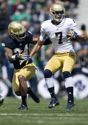 April 20, 2013: Notre Dame Fighting Irish wide receiver TJ Jones (7) is catches the ball as Notre Dame Fighting Irish cornerback Josh Atkinson (24) defends during the Notre Dame Blue-Gold Spring game at Notre Dame Stadium in South Bend, Indiana.  The Defense topped the Offense by a score of 54-43.