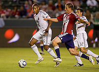 CD Chivas USA forward Justin Braun attempts to move around DC United players Jordan Graye (16) and Jed Zayner (12). CD Chivas USA beat DC United 1-0 at Home Depot Center stadium in Carson, California on Sunday August 29, 2010.
