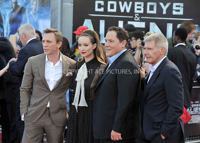 WWW.ACEPIXS.COM . . . . .  ..... . . . . US SALES ONLY . . . . .....August 11 2011, London....Actors Daniel Craig, Olivia Wilde, director Jon Favreau and actor Harrison Ford arriving at the 'Cowboys and Aliens' UK film premiere at the 02 Arena on August 11, 2011 in London, England.....Please byline: FAMOUS-ACE PICTURES... . . . .  ....Ace Pictures, Inc:  ..Tel: (212) 243-8787..e-mail: info@acepixs.com..web: http://www.acepixs.com
