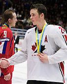 Viacheslav Buravchikov (Ak Bars Kazan), Jonathan Toews (Winnipeg, MB - University of North Dakota Fighting Sioux) - Team Canada (gold), Team Russia (silver) and Team USA line up for the individual awards and team medal presentations following Team Canada's 4-2 victory over Team Russia to win the gold in the 2007 World Championship on Friday, January 5, 2007 at Ejendals Arena in Leksand, Sweden.